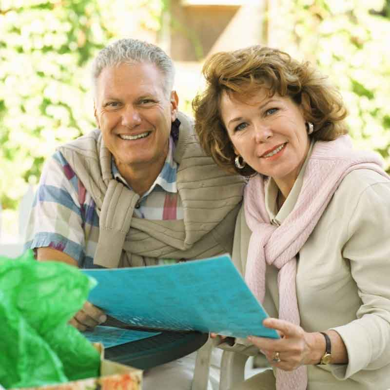 retired couple looking at blueprint