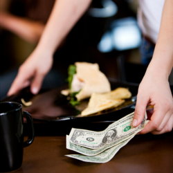 waitress picking up cash.png