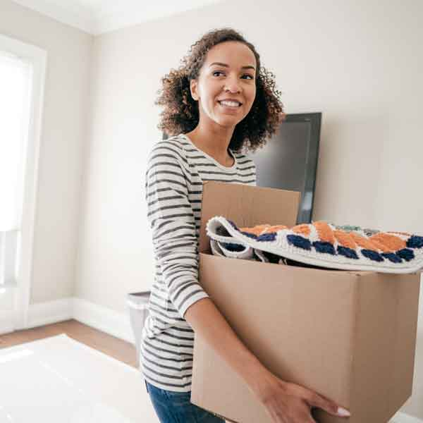 woman-carrying-box-of-household-items
