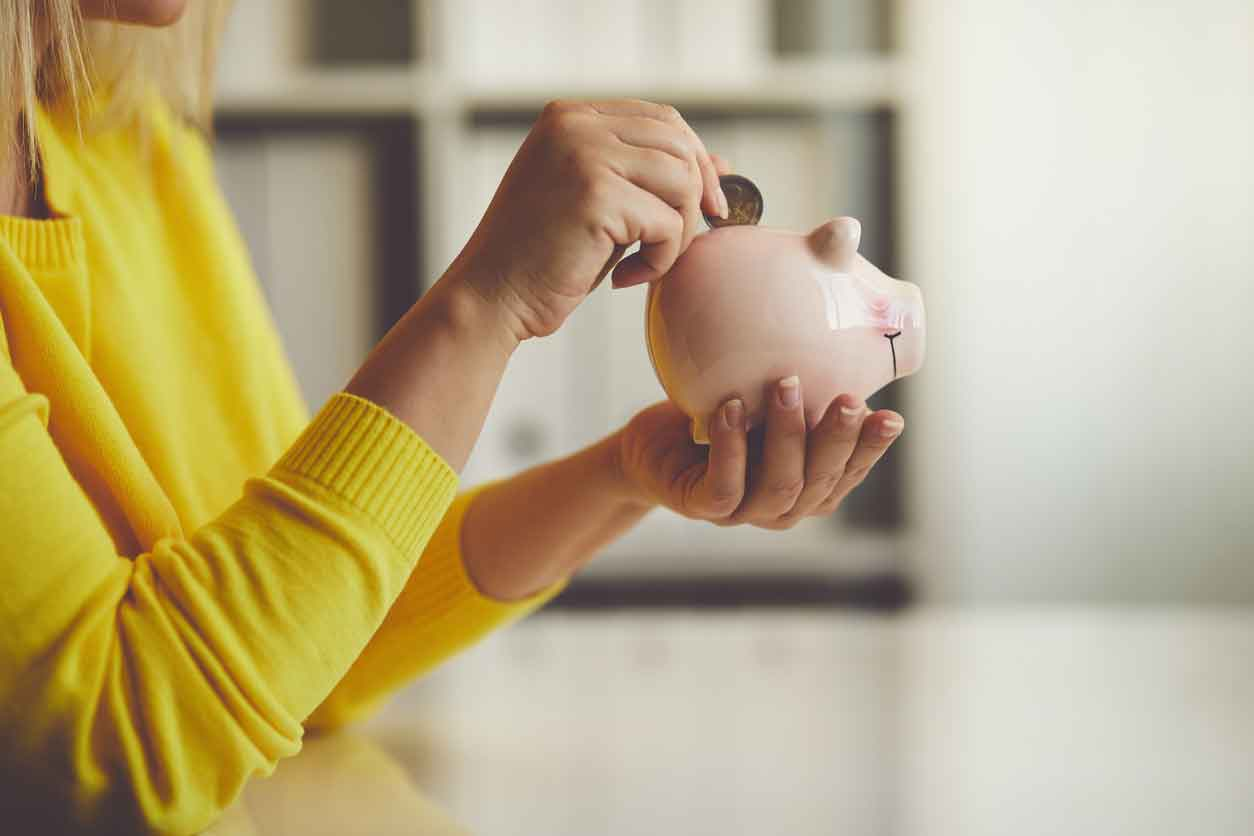 woman-putting-coin-in-piggy-bank_opt